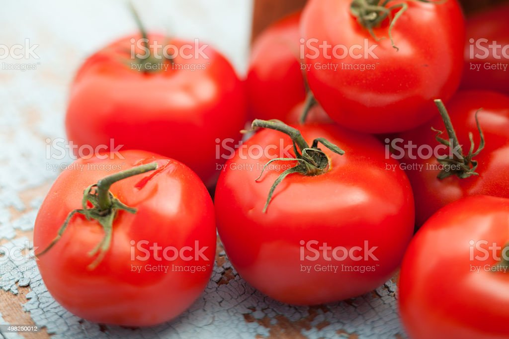 Fresh tomatoes on rustic wood table stock photo