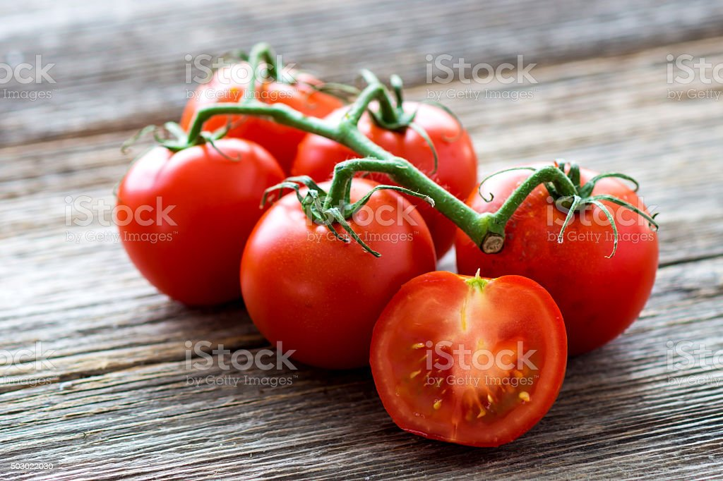 Fresh tomatoes on wood background stock photo