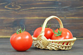 istock Fresh tomatoes on wooden background 970271278