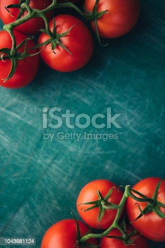 Fresh grape tomatoes on a green chalkboard background