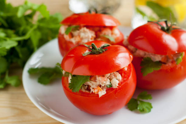 Fresh tomatoes stuffed with canned tuna stock photo