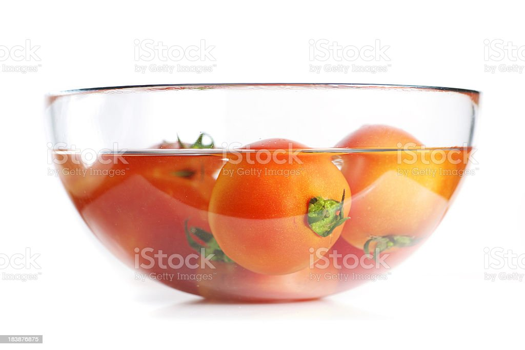 Fresh tomatos in glass bowl stock photo