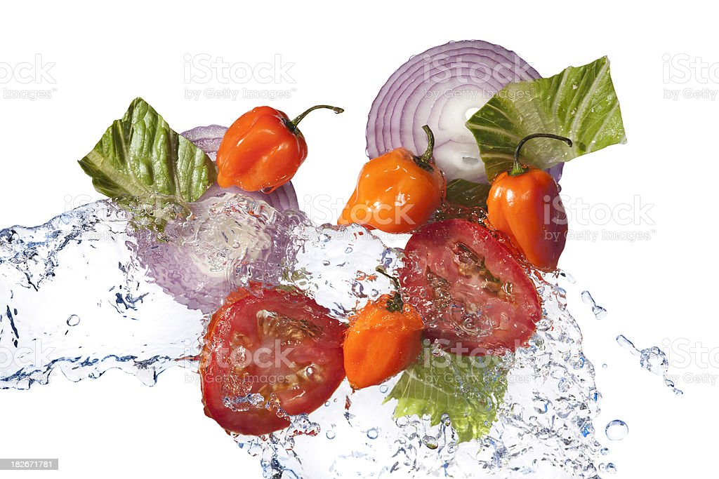 Fresh Tossed Salad Ingredients; Peppers,Tomatoes, Onion, lettuce, Water stock photo
