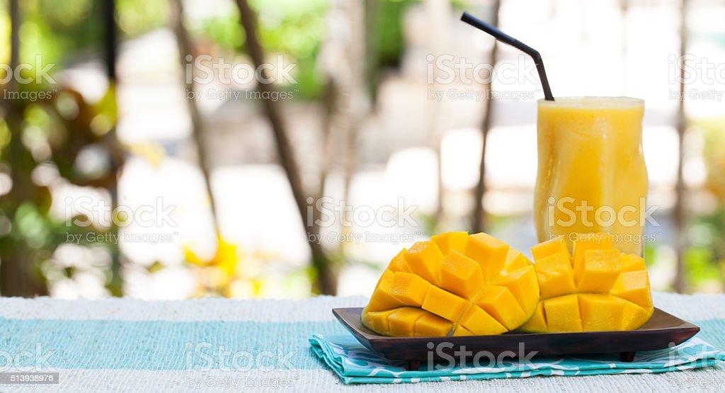 Fresh tropical fruit smoothie mango juice and fresh mango stock photo