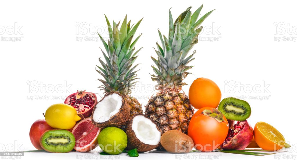 Fresh Tropical Fruits. Pineapple, coconut, kiwi, orange, pomegranate, grapefruit. On a wooden background. Top view. Free space for text. stock photo