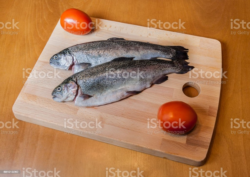 Fresh trout on wooden cutting board royalty-free stock photo