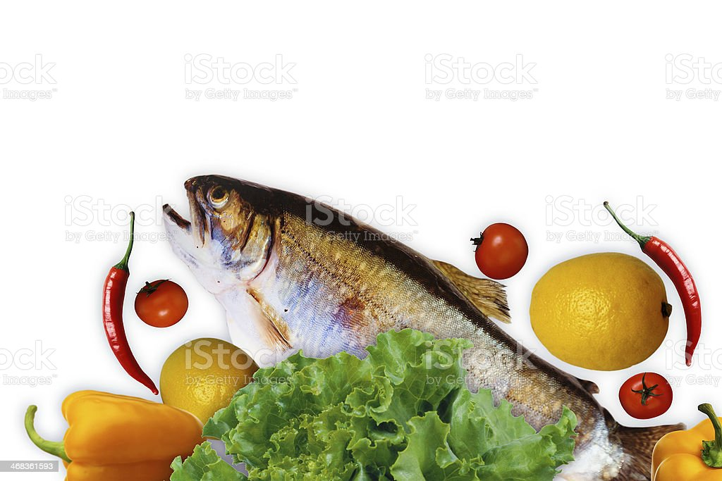 Fresh trout with lemon and vegetables on a white background stock photo