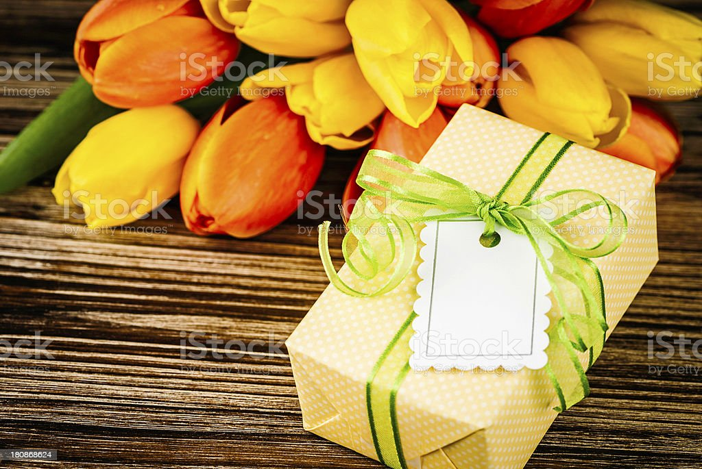 Fresh Tulip Bouquet with Gifts royalty-free stock photo