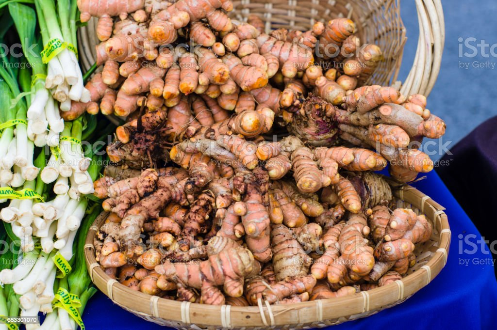 Fresh tumeric root in basket foto stock royalty-free