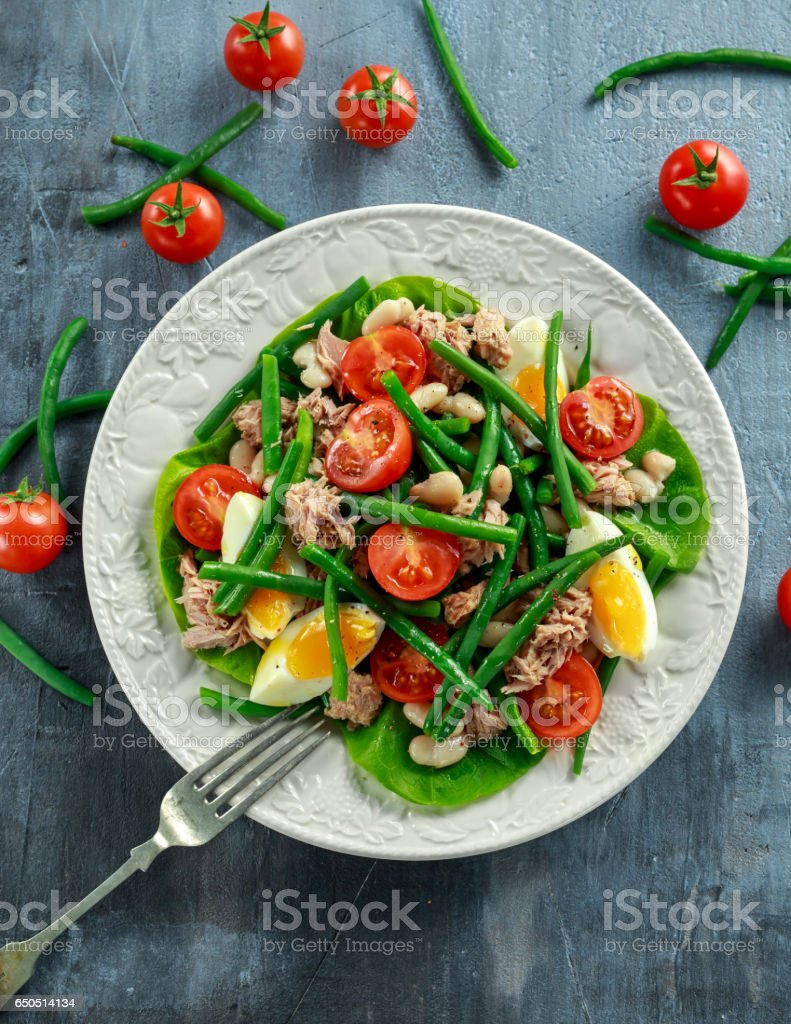 Fresh Tuna Green Bean salad with eggs, tomatoes, beans on white plate. concept healthy food stock photo