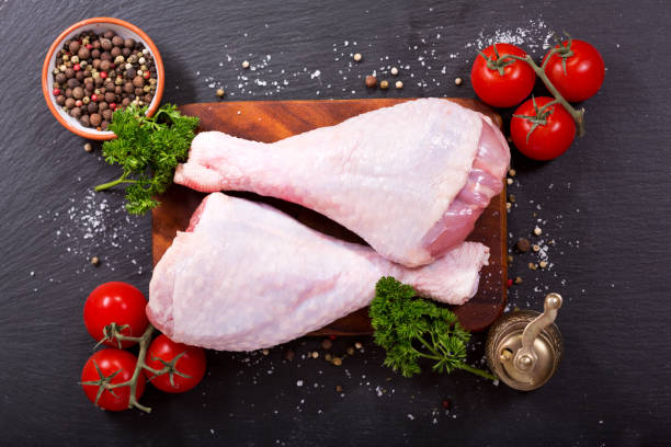fresh turkey legs with ingredients for cooking stock photo