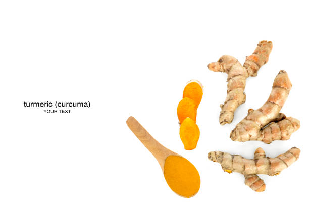 Fresh turmeric and powder in a wooden spoon on a white background with clipping paths. stock photo