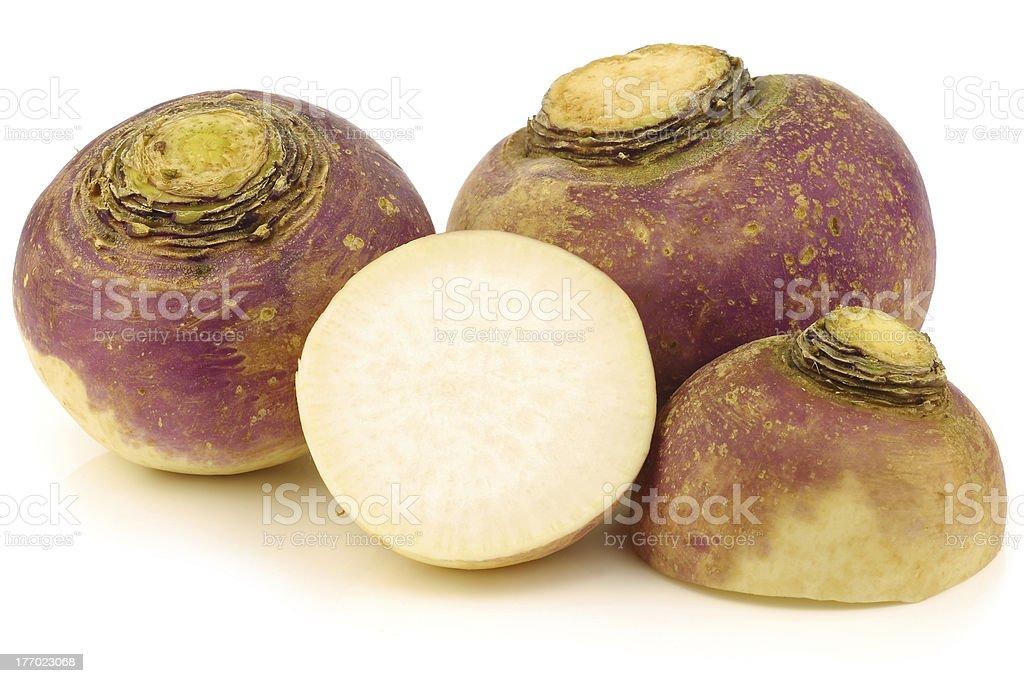 fresh turnips and a cut one stock photo