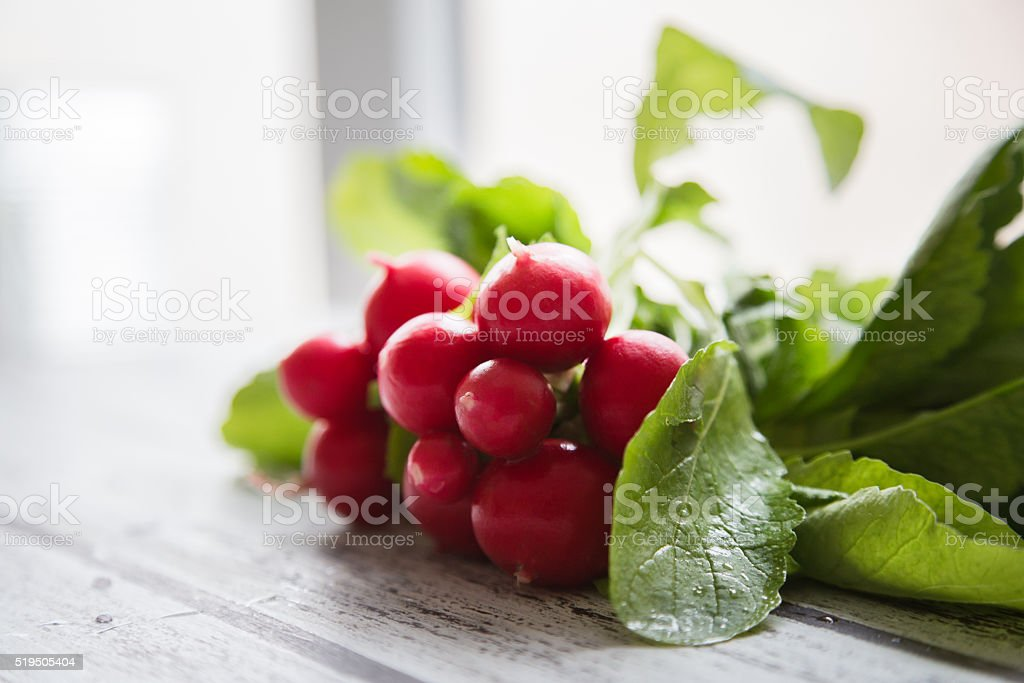 Fresh turnips on a kitchen bench stock photo