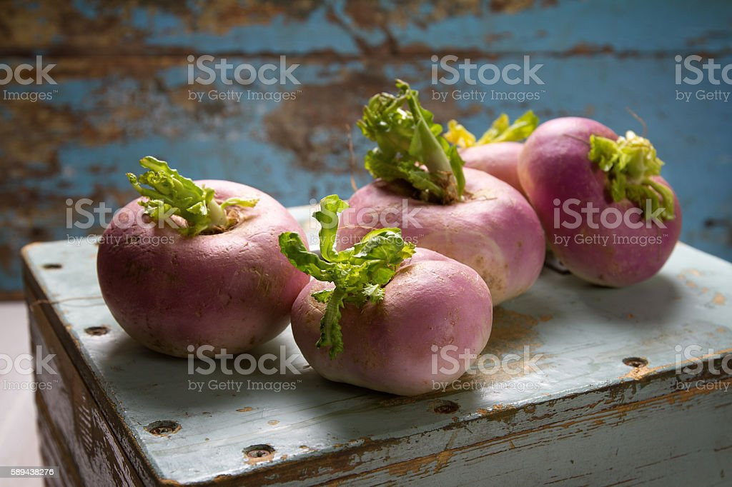 Fresh turnips on an old wooden box stock photo