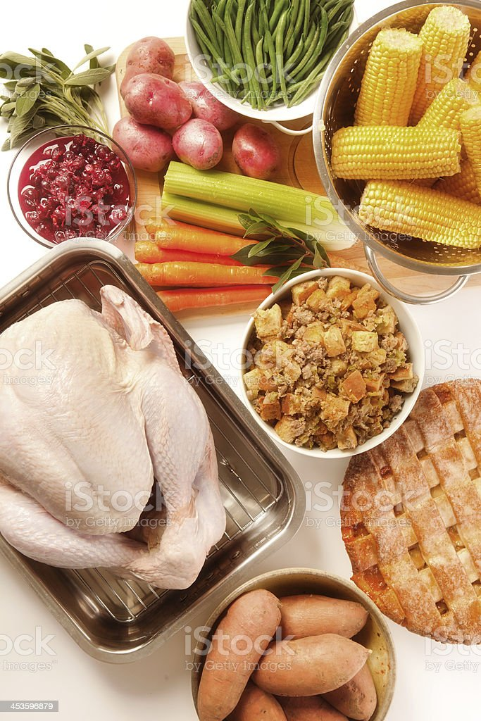 Fresh Uncooked Turkey, Thanksgiving Ingredients High Angle View, White Background royalty-free stock photo