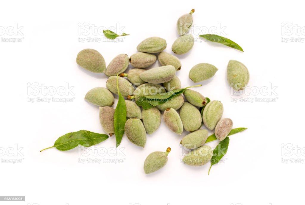 Fresh unripe almonds on white background top view stock photo