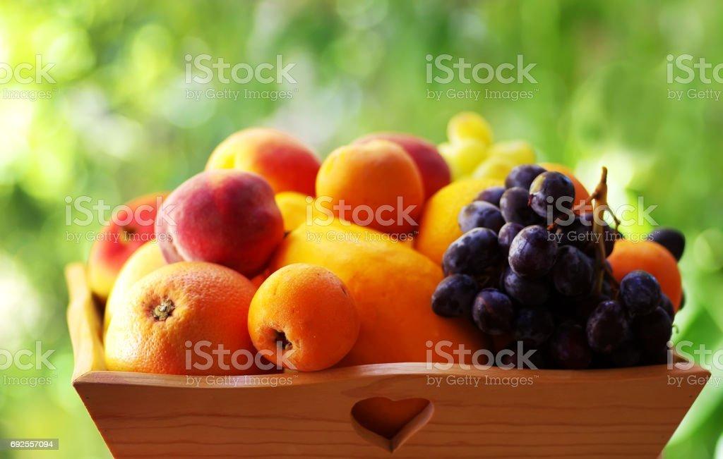 fresh various fruits on wooden basket stock photo