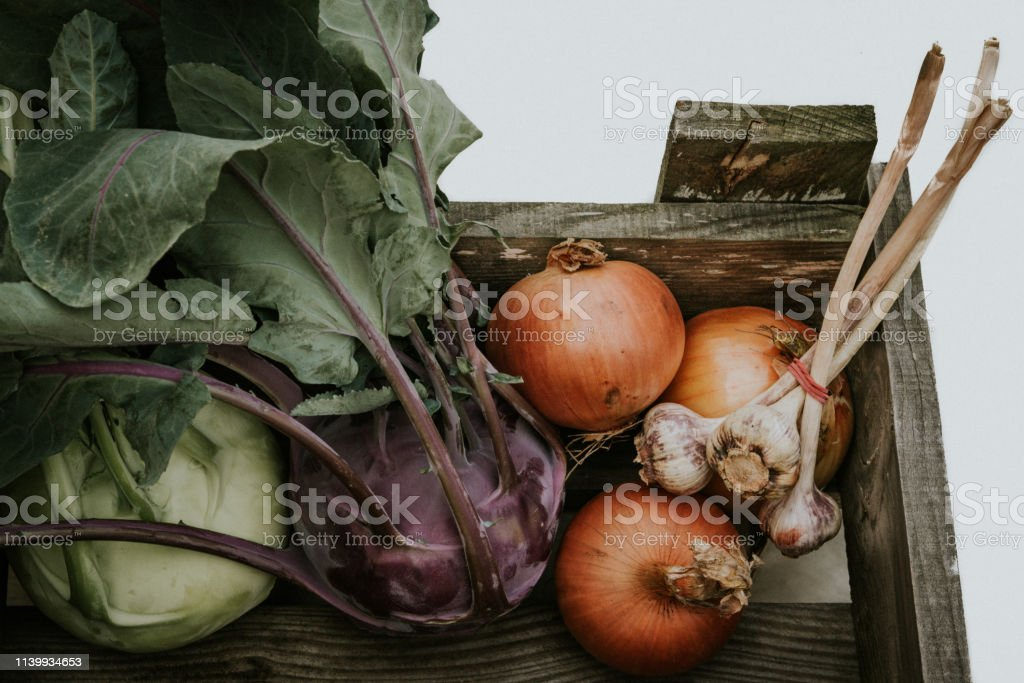 Fresh vegetable box Organic wooden box with carrots, salted, onions,...