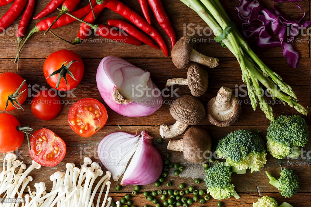 Fresh vegetable cooking ingredients on rustic wooden table stock photo