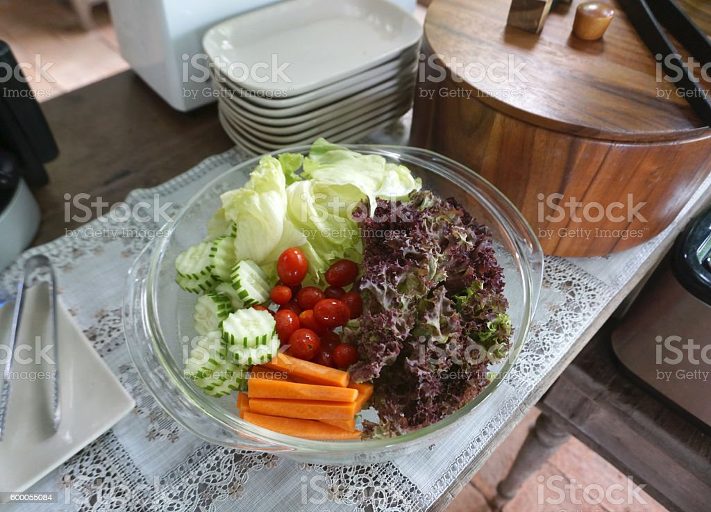 fresh vegetable for salad in glass bowl stock photo