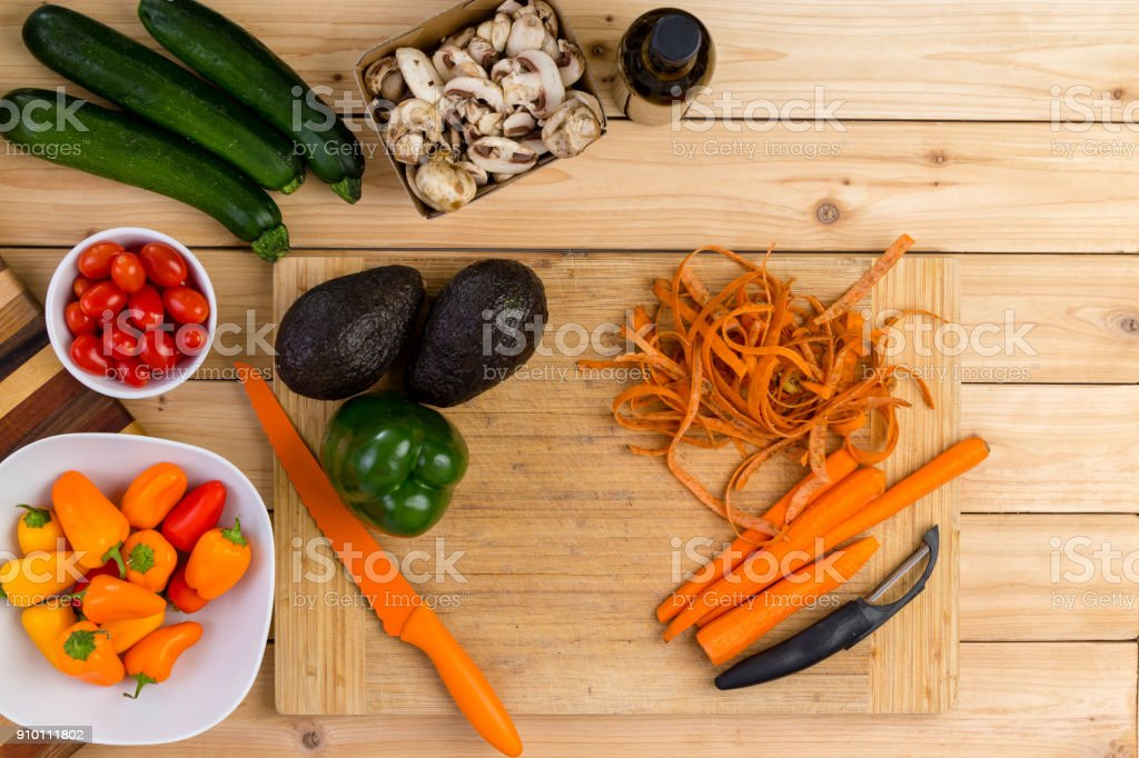Fresh vegetable ingredients on a kitchen table stock photo