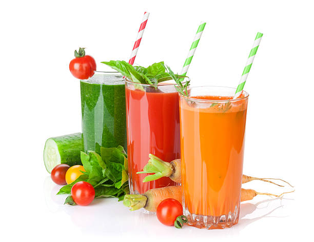 Fresh vegetable juices. Tomato, cucumber, carrot Fresh vegetable juices. Tomato, cucumber, carrot. Isolated on white background vegetable juice stock pictures, royalty-free photos & images