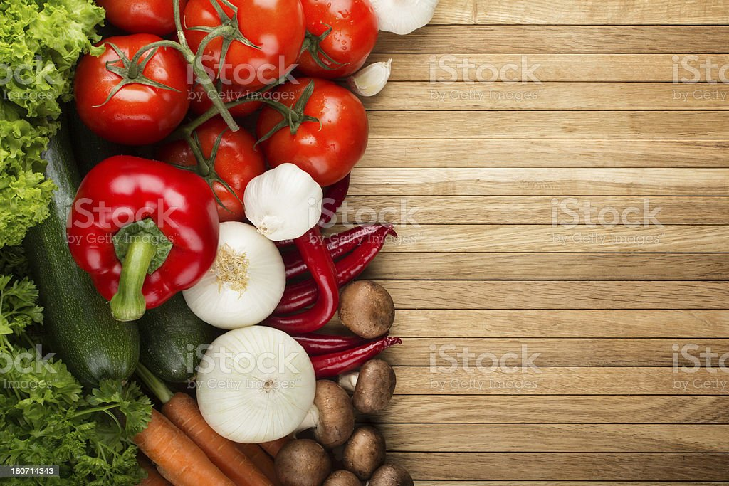 Fresh vegetable mix on wooden surface royalty-free stock photo