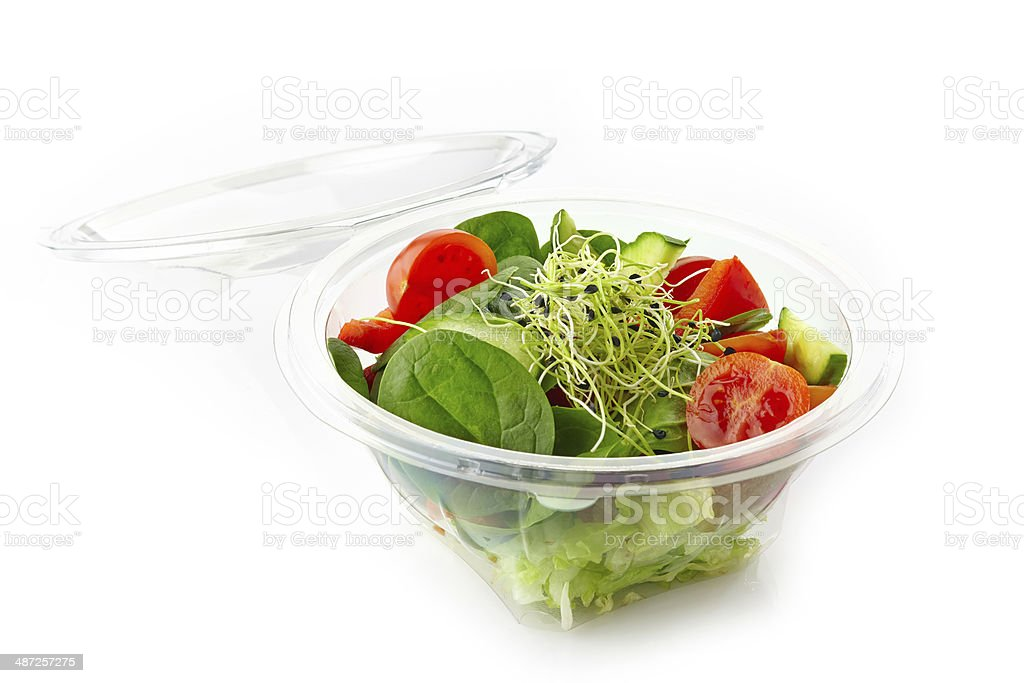 fresh vegetable salad in a plastic take away bowl stock photo