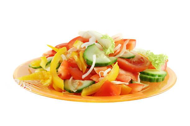 Fresh vegetable salad isolated on white stock photo