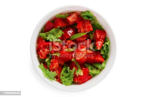 Fresh vegetable salad in a porcelain cup. View from above