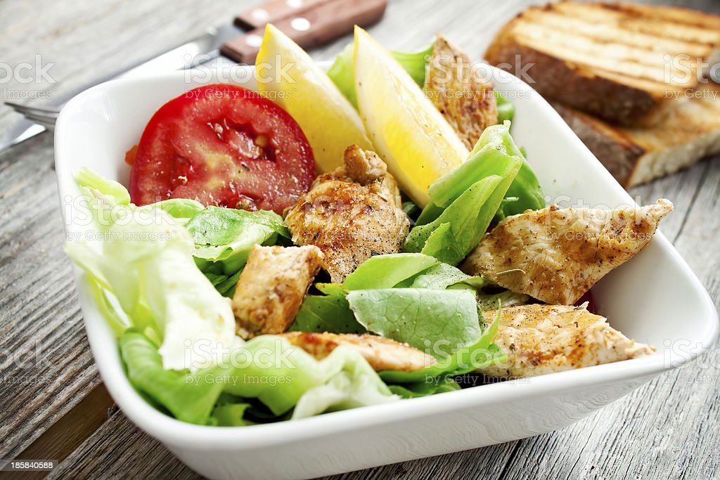 Fresh vegetable salad with grilled chicken breast  royalty-free stock photo
