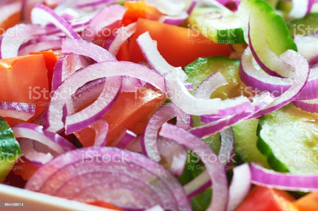Fresh vegetable salad with onion and tomatoes macro view stock photo