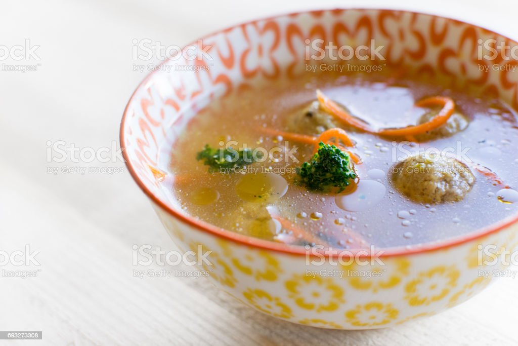 Fresh Vegetable Soup  with Dumplings in Colorful Bowl stock photo