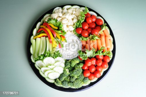 A delicious fresh vegetable tray with dip.