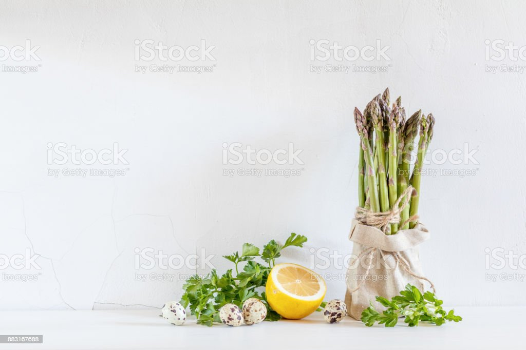 Fresh vegetables and asparagus in a little sack stock photo