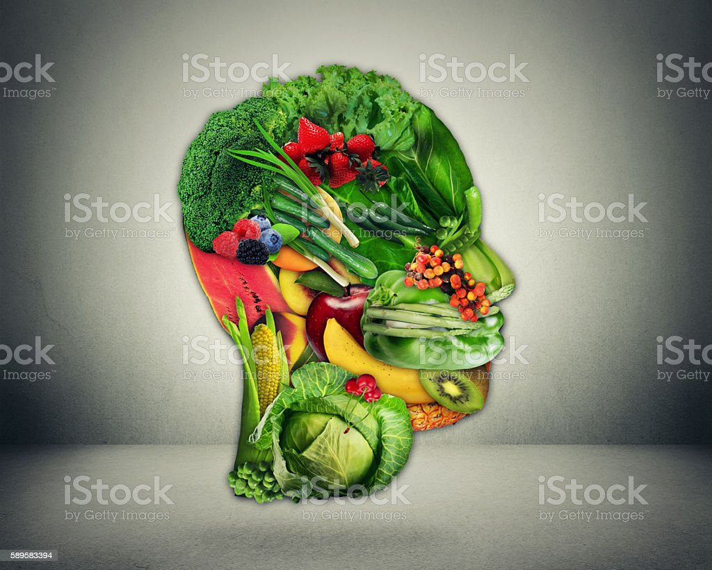 Fresh vegetables and fruit shaped as human head stock photo