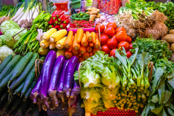 Fresh vegetables and fruits at local market in Sanya, Hainan, China Fresh vegetables and fruits at local market in Sanya, Hainan province, China brassica rapa stock pictures, royalty-free photos & images