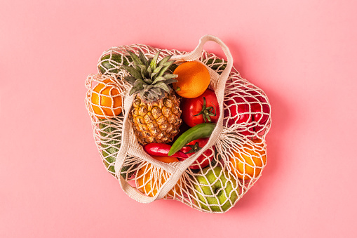 istock Fresh vegetables and fruits in bag mesh 1147770083