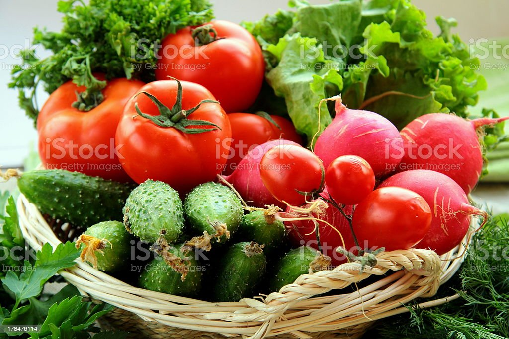 fresh vegetables and herbs mix in a wicker basket royalty-free stock photo