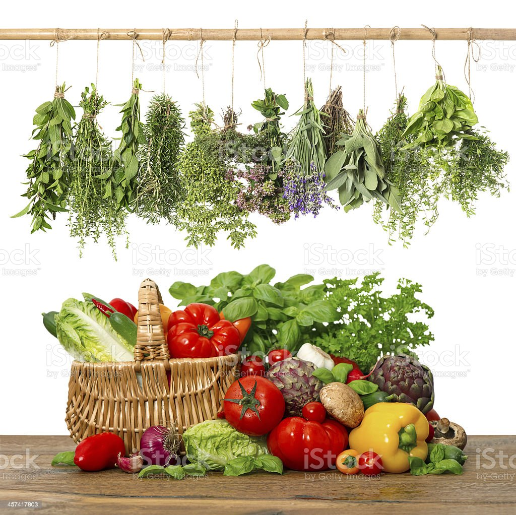 fresh vegetables and herbs.shopping basket. kitchen interior stock photo
