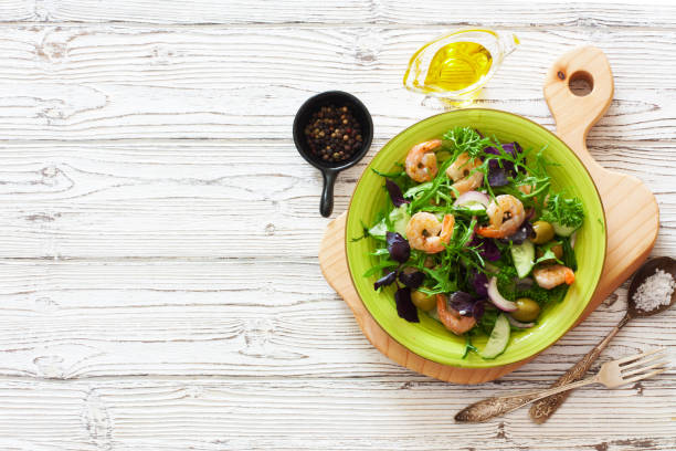 Fresh vegetables and shrimps salad stock photo