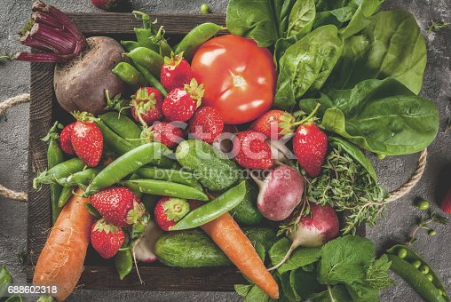 istock Fresh vegetables, berries, greens and fruits in tray 688602318