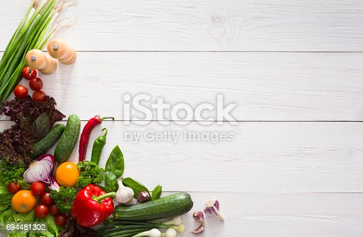 istock Fresh vegetables border on white wood background with copy space 694481302