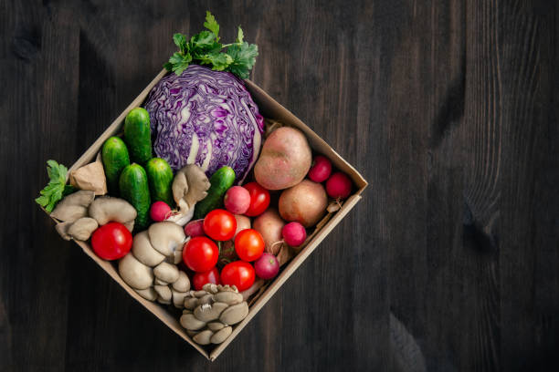 Fresh vegetables home delivery in a paper box stock photo