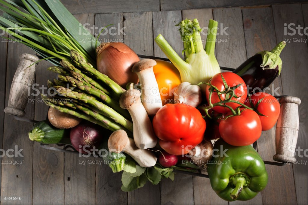 Fresh vegetables in a basket stock photo