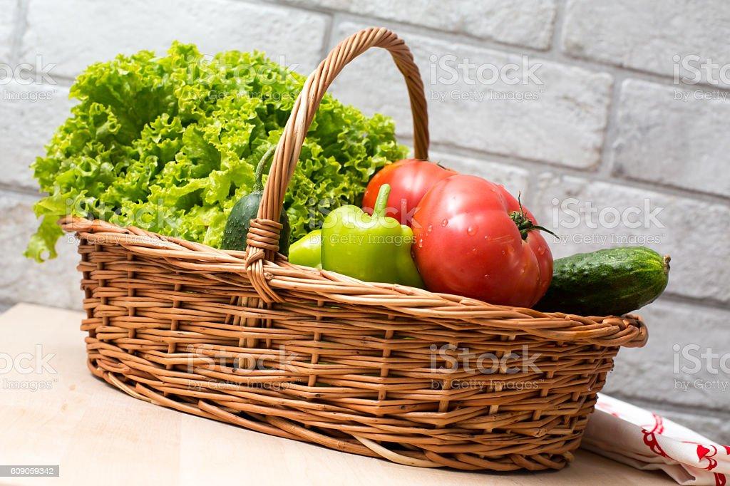 Fresh vegetables in basket. Tomato, cucumber, pepper and lettuce stock photo