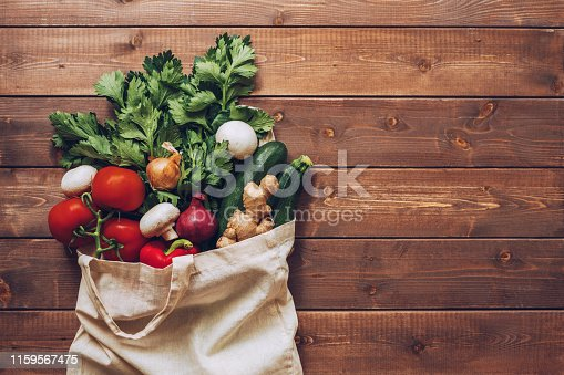 Fresh vegetables in the eco cotton bag at the kitchen counter
