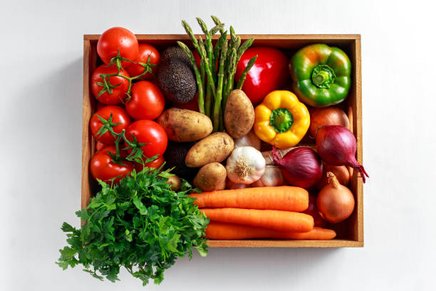Fresh Vegetables in wooden box on white wooden background stock photo