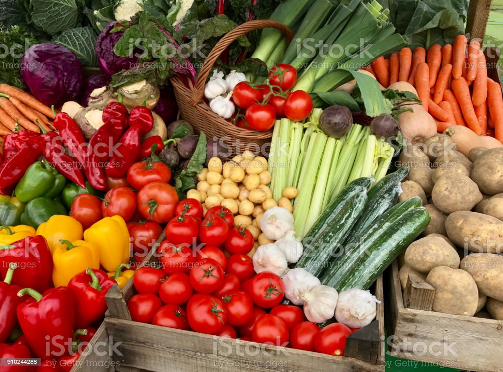 Fresh vegetables market stand stock photo